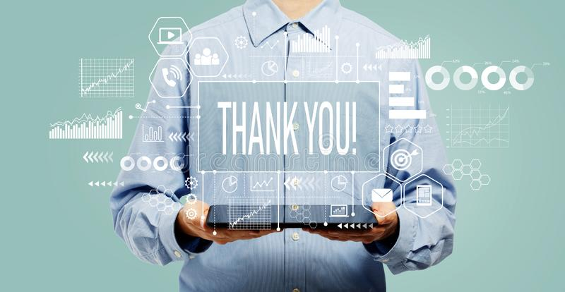 Thank you message with man holding a tablet royalty free stock photos