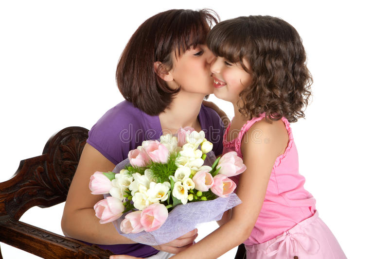 Thank you from mom. Happy mother kissing her daughter on mother's day royalty free stock photo