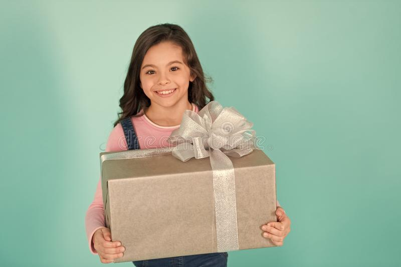 Thank you so much. Child happy face holds big gift box turquoise background. Kid girl delighted gift. Girl curly. Hairstyle adorable happy face celebrate royalty free stock photos