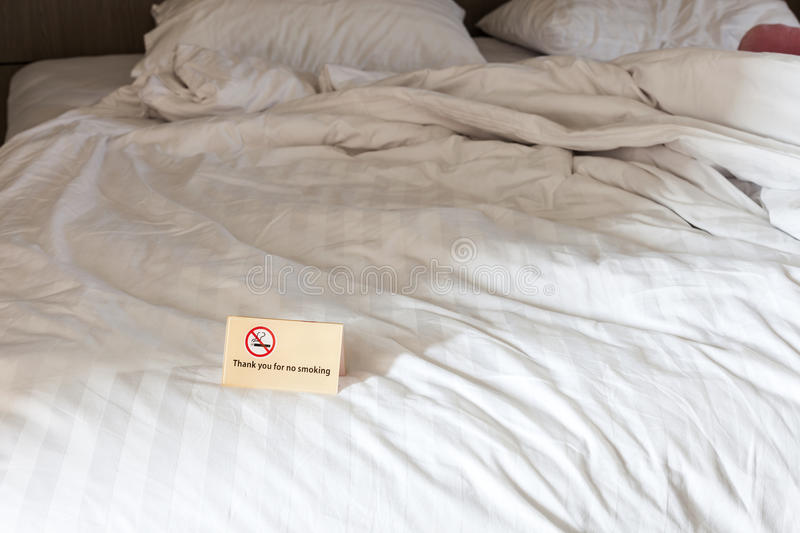 Thank you for no smoking Sign on the bed in hotel room. stock photos