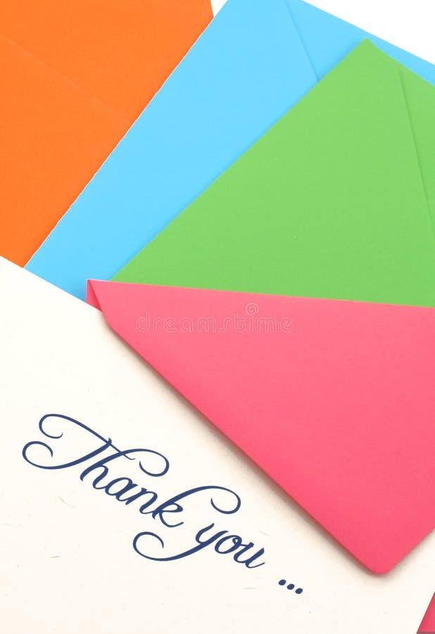 Thank you note and envelopes stock photos