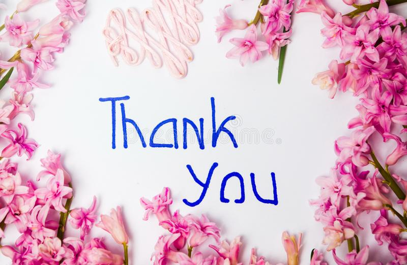Thank you note with hyacinth spring flowers arrangement stock photography