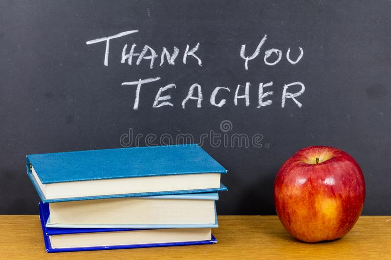 Thank you teacher thanks teach learn appreciation gift. Letterpress black board bribe school student students knowledge learning reading books black board royalty free stock image