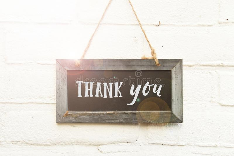 Thank you text handwritten typography on chalkboard hanging on w royalty free stock photography