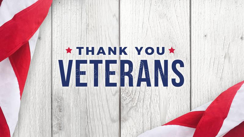 Thank You Veterans Text with American Flag Over White Wood Background royalty free illustration