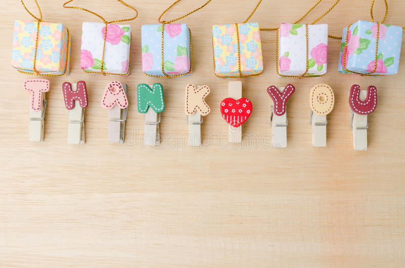 Thank you word of clothesline with gift boxes on wooden table stock photo