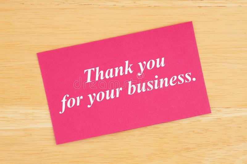 Thank you for your business text on pink card stock photo