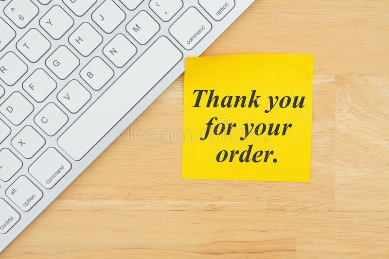 Thank you for your order text on a sticky note with a keyboard. On a desk royalty free stock image