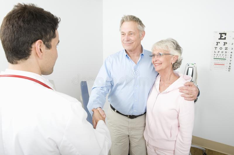 Thankful Man Shaking Hands With The Doctor stock images