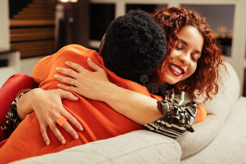 Thankful happy wife hugging her loving man after amazing surprise. Thankful wife. Thankful happy wife hugging her loving caring men after amazing surprise stock photo