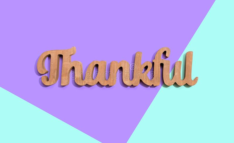 Thankful wooden text from above stock photo