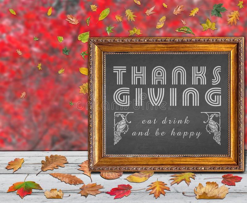 Thanks giving day design quote with colored autumn leaves. Background stock photography