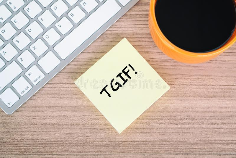 Thanks God Its Friday TGIF quote on memo. With cup of coffee and computer keyboard stock photo