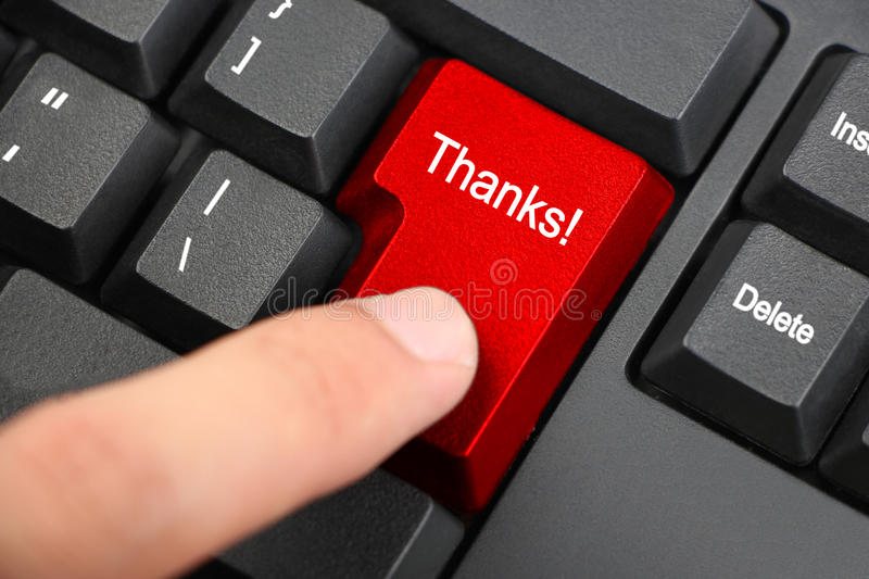 Thanks!. Hand press a red key with text Thanks on black keyboard royalty free stock photography
