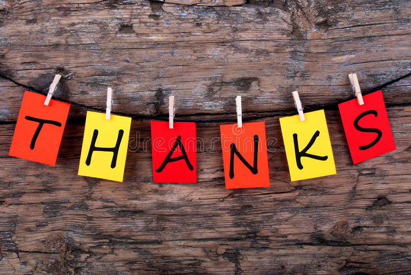 Thanks on a Line. The Word Thanks on Colorful Tags on a Line on Wood royalty free stock image