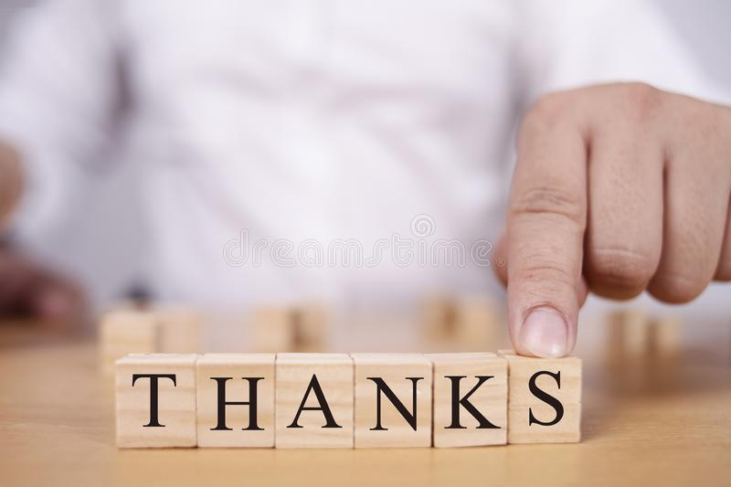 Thanks, Motivational Words Quotes Concept. Thanks, thank you words letter, wooden motivational business typography quotes concept gratitude text card greeting stock photo