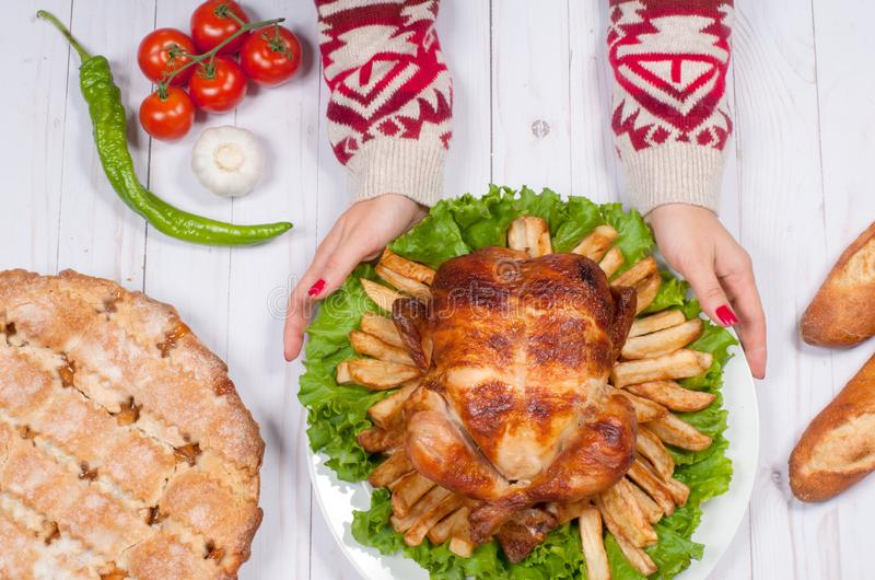 Thanksgiving or Christmas. Homemade roasted whole turkey on wooden table. Thanksgiving Celebration Traditional Dinner Setting. Food Concept stock photo