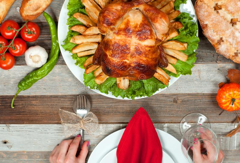 Thanksgiving or Christmas. Homemade roasted whole turkey on wooden table. Thanksgiving Celebration Traditional Dinner Setting. Food Concept royalty free stock photos