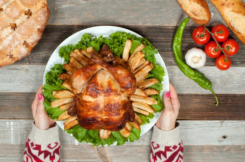 Thanksgiving or Christmas. Homemade roasted whole turkey on wooden table. Thanksgiving Celebration Traditional Dinner Setting. Food Concept stock photography