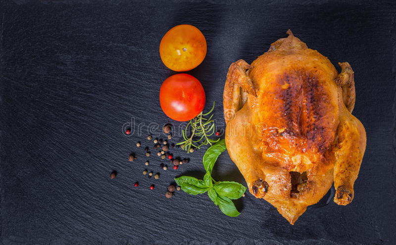 Thanksgiving concept with roasted Turkey, tomato, dry peppers, r royalty free stock photography