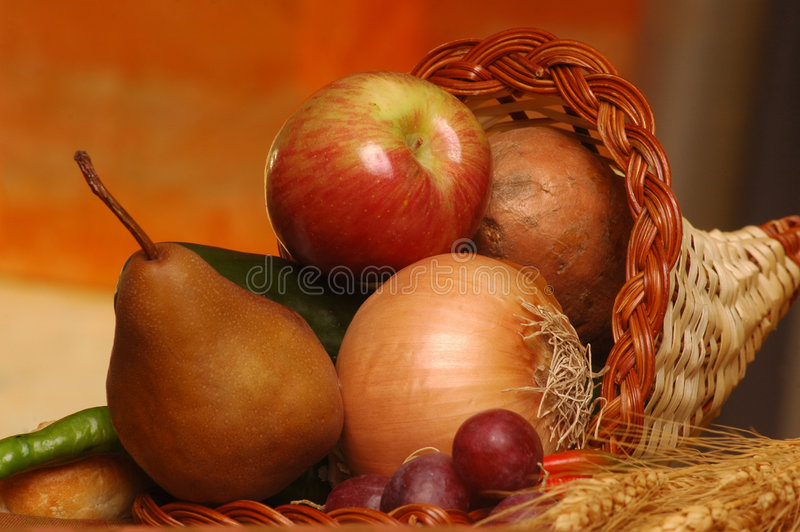 Thanksgiving cornucopia. With assorted fruits and vegetables