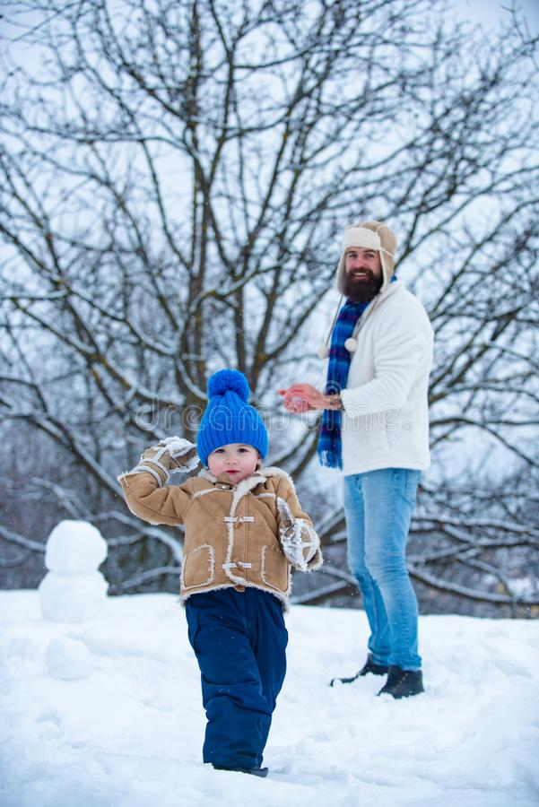 Thanksgiving day and Christmas. Happy smiling family on sunny winter day. Christmas background. Father and son in snow. Thanksgiving day and Christmas. Happy royalty free stock photo