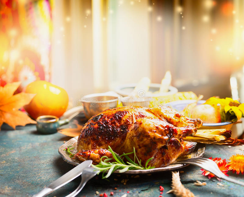 Thanksgiving Day dinner table with roasted turkey royalty free stock photo
