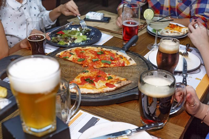 Thanksgiving Day, Friendly dinner, Beer, pizza, close up royalty free stock photo