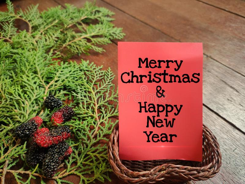 Thanksgiving day. Merry Christmas & happy new year written on card with fresh ornaments background. Holiday, table, home, phrase, pattern, new, decoration royalty free stock photo