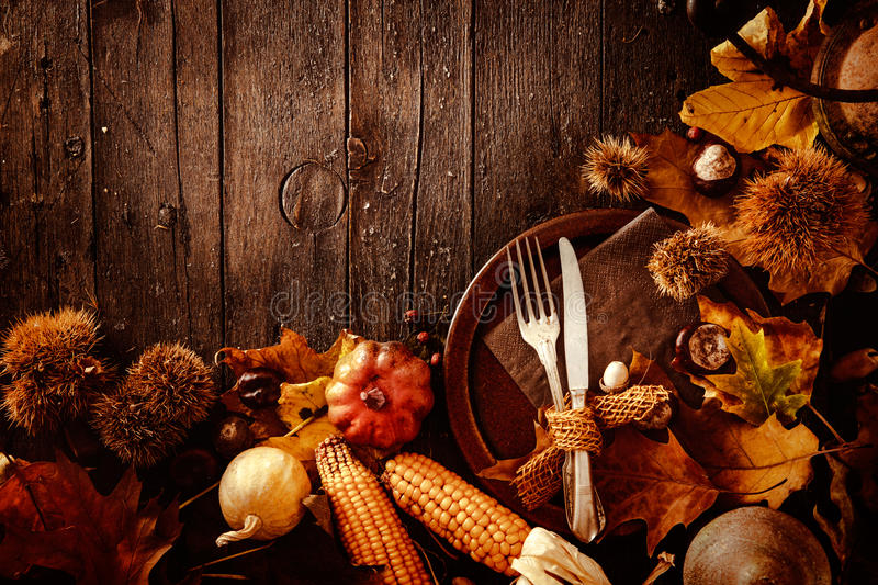 Thanksgiving dinner. Autumn fruit with plate and cutlery. Thanksgiving autumn background stock photography