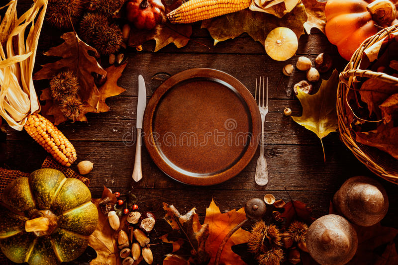 Thanksgiving dinner. Autumn fruit with plate and cutlery. Thanksgiving autumn background stock photo