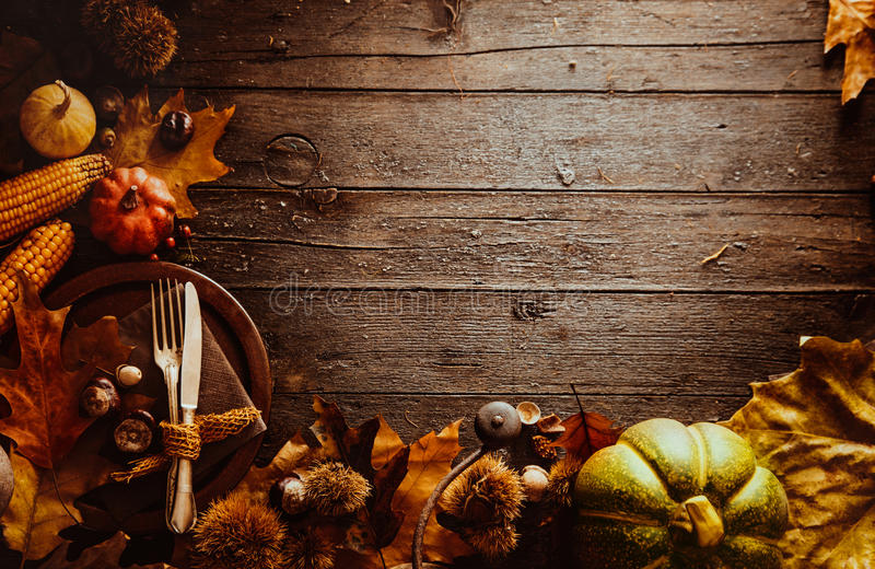 Thanksgiving dinner. Autumn fruit with plate and cutlery. Thanksgiving autumn background stock images