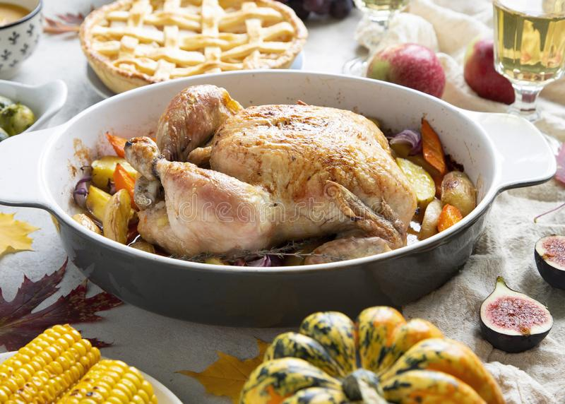 Thanksgiving dinner with chicken, apple pie, pumpkin soup brussel sprouts and fruits stock photo