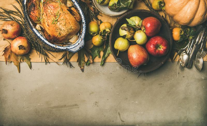 Thanksgiving dinner table setting with roasted chicken or turkey royalty free stock photo
