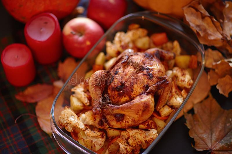 Thanksgiving Dinner. Thanksgiving table served with turkey, decorated with bright autumn leaves. stock photos