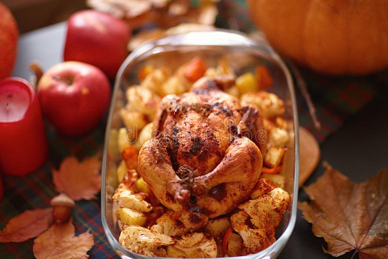 Thanksgiving Dinner. Thanksgiving table served with turkey, decorated with bright autumn leaves. stock photo