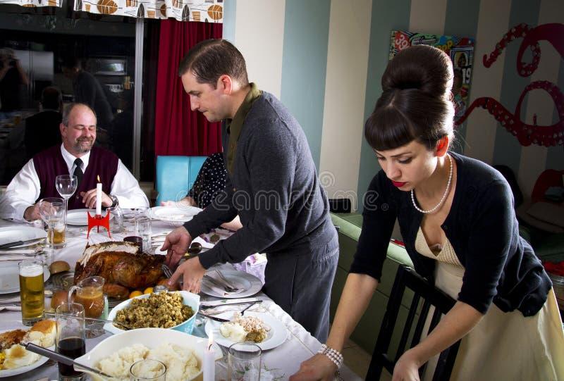Retro Family Thanksgiving Dinner Turkey Carving stock photography