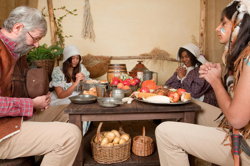 Download Thanksgiving Family Giving Thanks Stock Photo - Image of indian, pumpkin: 21594030