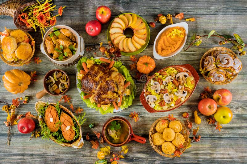 Thanksgiving holiday table served with turkey and a lot of food. Thanksgiving holiday table served with roasted turkey and a lot of food, dinner, celebration stock photo
