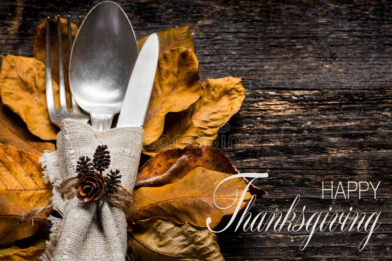 Thanksgiving Meal Setting. Seasonal table setting. Thanksgiving autumn place setting with cutlery and autumn leaves. royalty free stock image
