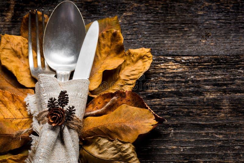 Thanksgiving Meal Setting. Seasonal table setting. Thanksgiving autumn place setting with cutlery. stock photos
