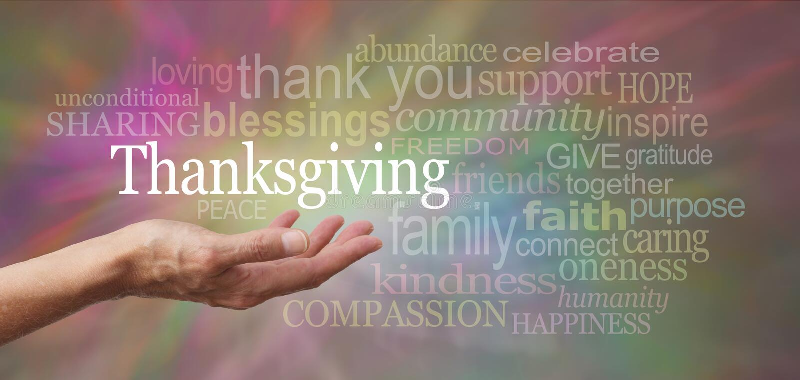 Thanksgiving in the palm of your hand. Female hand outstretched with palm side up and a white 'Thanksgiving' word floating above on a multicolored background