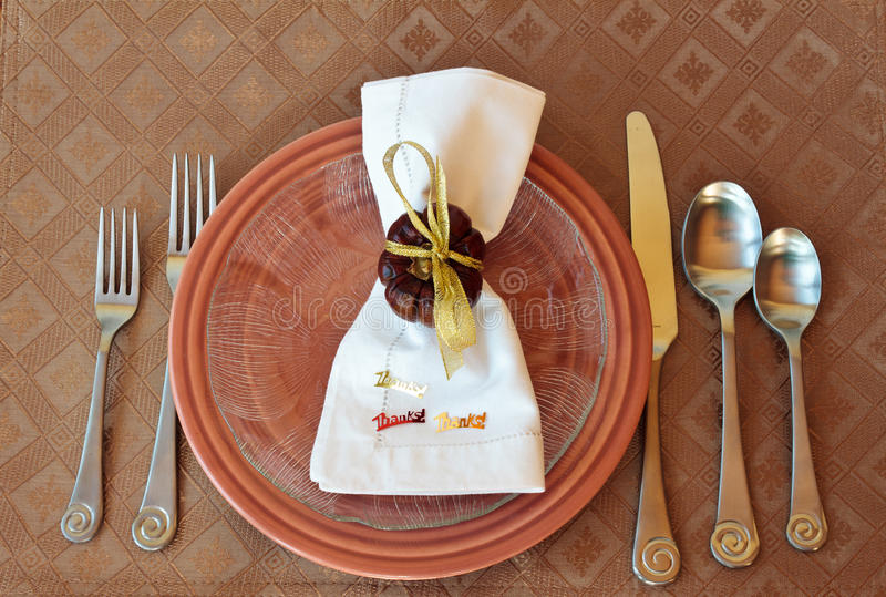 Thanksgiving Place setting. With plates, cloth, silverware, and decorated napkin royalty free stock photos