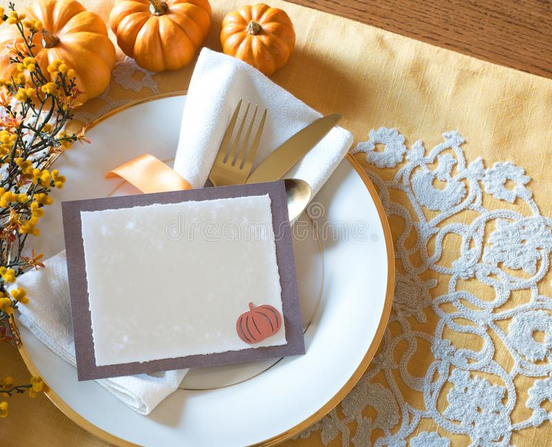 Thanksgiving Place Setting with Menu Card with Blank Menu Card for your words, text or copy. Above View horizontal with silverwar royalty free stock photos