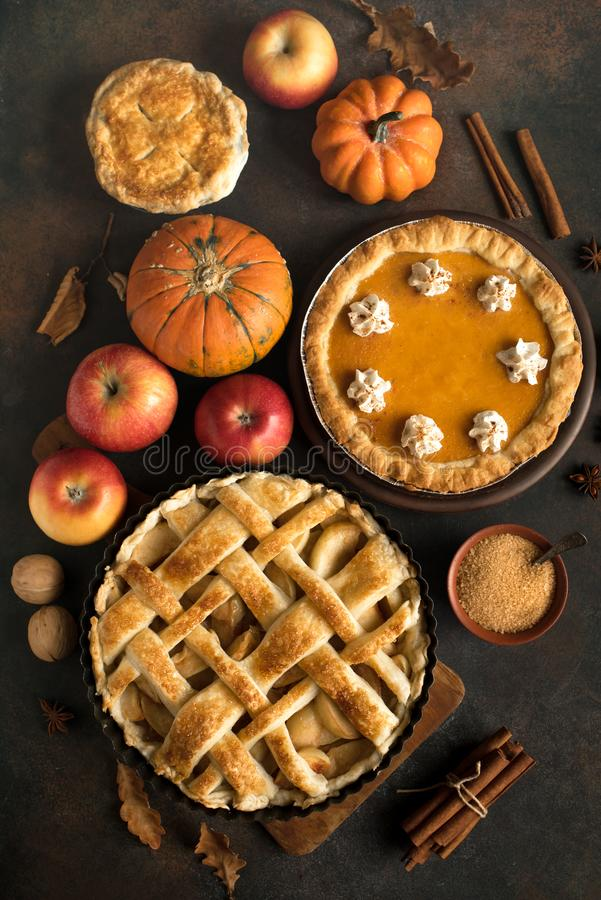 Thanksgiving pumpkin and apple various pies. Top view, copy space. Fall traditional homemade apple and pumpkin pie for autumn holiday stock photo