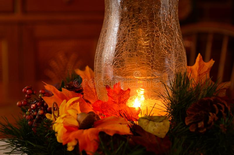 Thanksgiving table decorations add color to centerpiece. Giving thanks for family, friends, health, job security, and food on the dinner table. Image showing stock photo