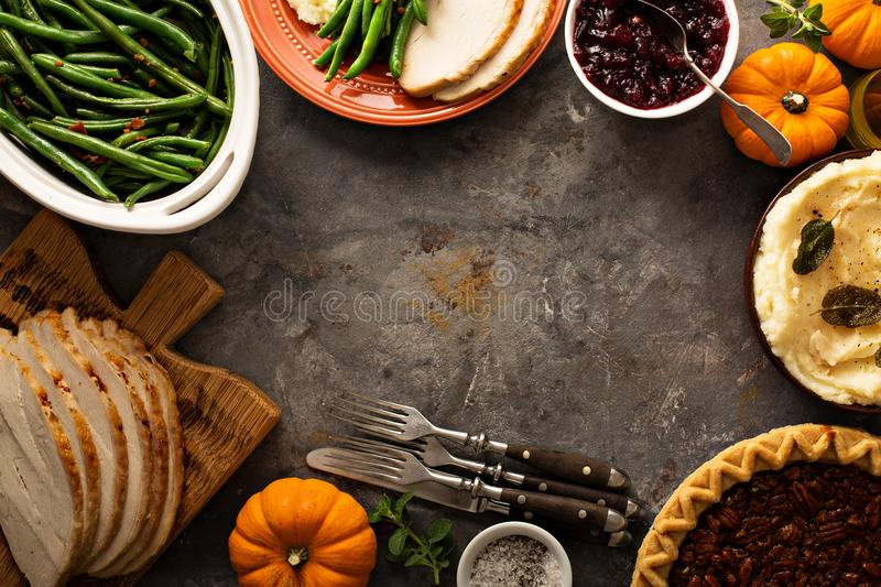 Thanksgiving table overhead shot. Thanksgiving table with turkey, green beans and mashed potatoes overhead shot stock images