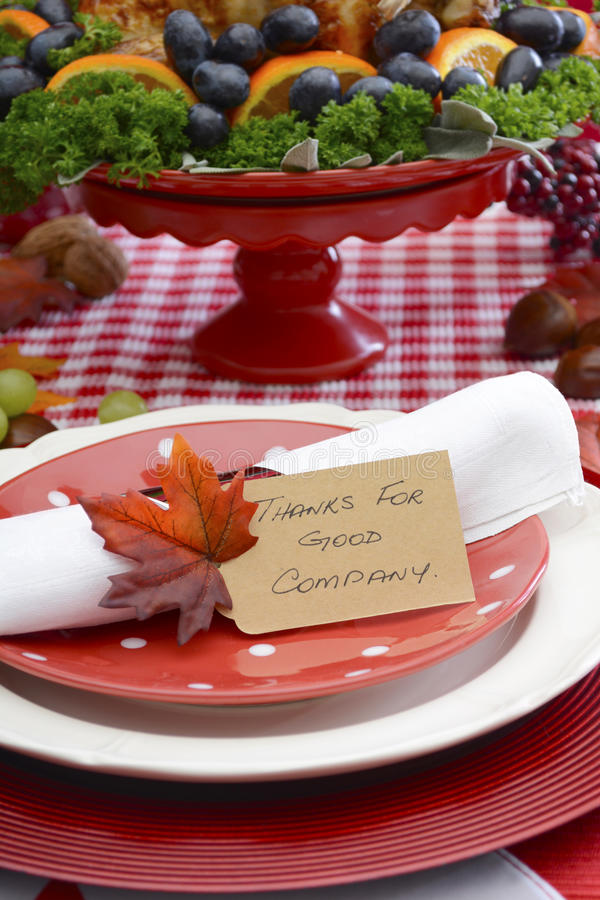 Thanksgiving Table Setting with Roast Turkey on Red White Backgr royalty free stock image