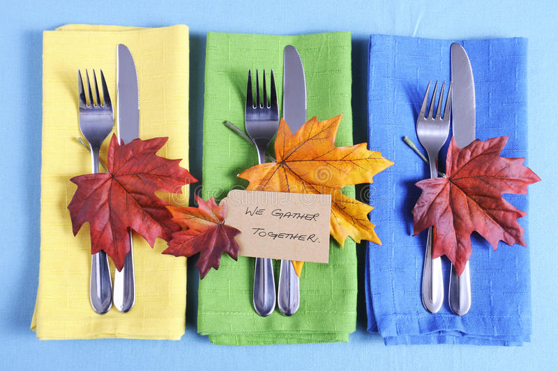 Thanksgiving tbale place setting in blue, green and yellow. stock photos