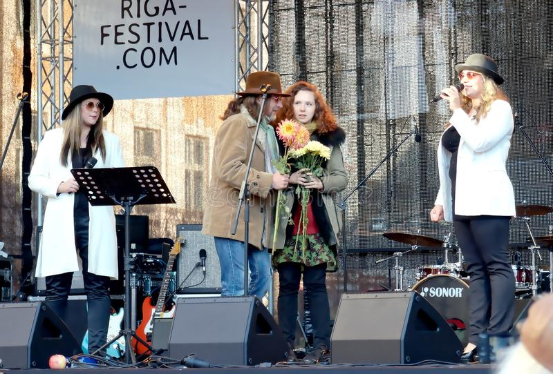 Thanksgiving to organizers of 75th Anniversary of John Lennon festival in Riga. Thanksgiving to organizers on the scene of Tribute festival 75th Anniversary of stock image
